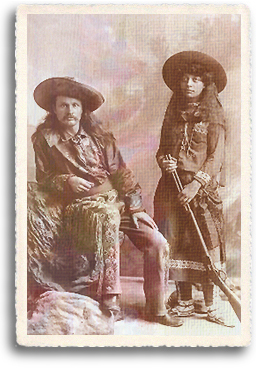 "Gordon ""Pawnee Bill"" and May Manning Lillie pose for a photograph in buckskins and with May"